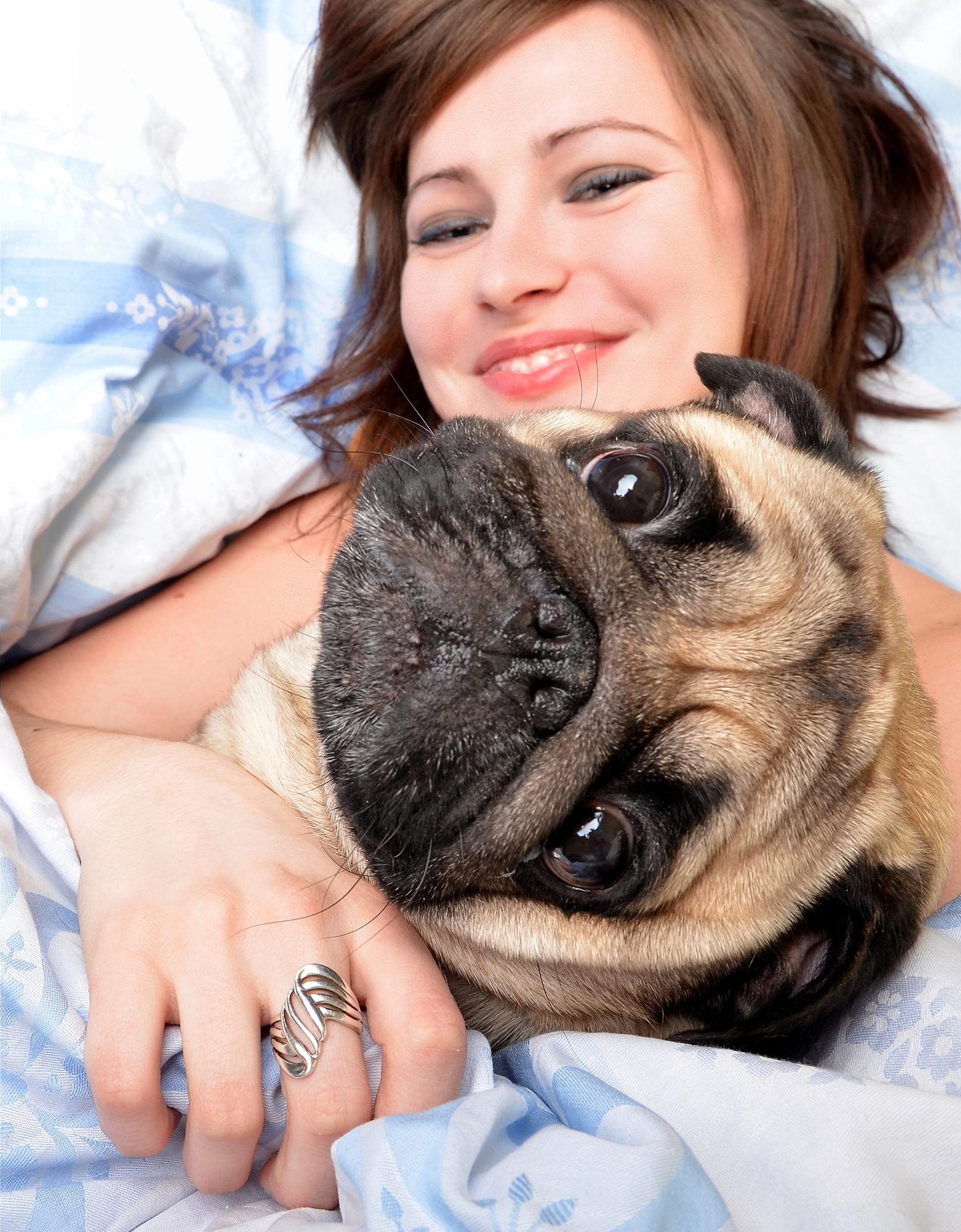 Owner-sleeping-with-pug-dog